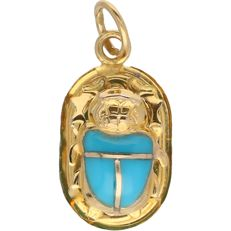 18 kt Yellow gold pendant in the shape of a scarab, partially blue enamelled – Length x width: 2.2 x 1 cm