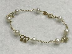 Bracelet in 18 kt gold with butterfly motifs and cultured pearls. For women.
