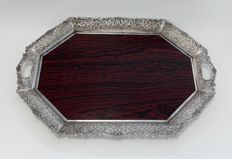 An octagonal wooden serving tray with lace silver plated edge with floral motifs, the Netherlands, Schoonhoven, Hubert Hooykaas