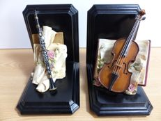 Book objects; Set of book ends with musical instruments - late 20th century