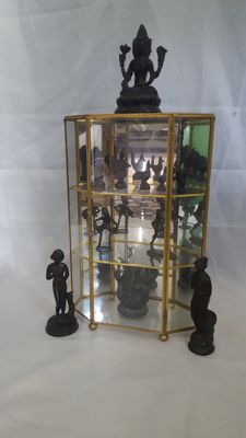 Cabinet with 11 items/figurines bronze