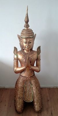 A gold-plated wooden kneeling Teppanom figure – Thailand – 2nd half 20th century