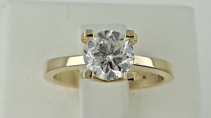 1.20 ct  round diamond ring made of 14 kt yellow gold - size 6,5