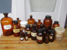 A set of 21 brown glass pharmacist jars/bottles