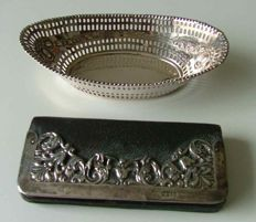 Silver bon bon dish hallmarked Chester England circa 1897 and Leather purse with silver decorative work London with import mark circa 1903.