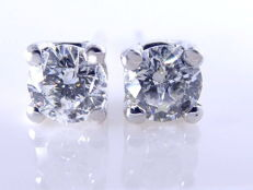 14 kt White gold solitaire ear studs set with 14 brilliant cut diamonds with IGI certificate, 2 ct in total