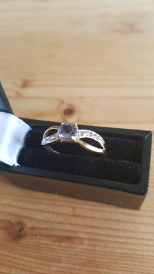 Gold cross over ring inlaid with tanzanite & diamonds. NO RESERVE PRICE!
