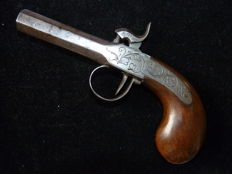 Antique single barrel percussion pistol.