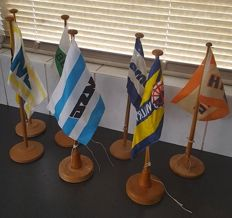 7 original shipping-company flags on wooden base