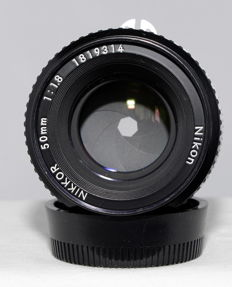 Nikkor 1:1.8-50 mm with HS 11 lens hood.