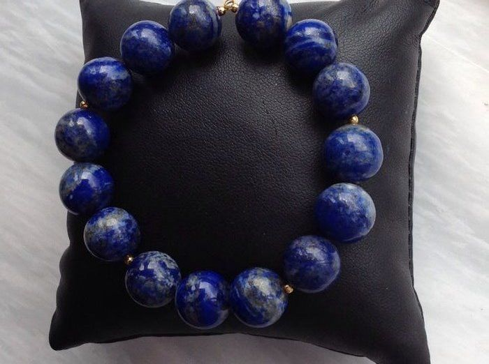 Lapis Lazuli bracelet 40 grams, length 20 cm with 18 kt yellow gold. Clasp.
