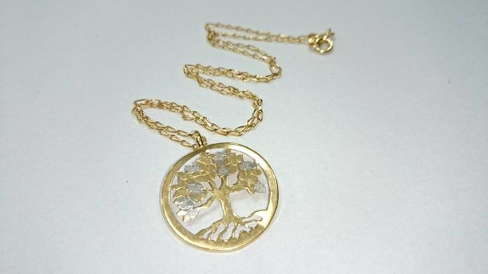 Tree of life necklace. 18 kt gold