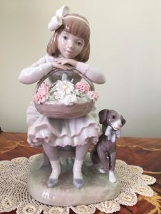 Lladro Porcelain Girl With Flowers  figurine