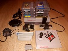 Nintendo Nes console with 10 games and accessories. Games like: Zelda 2 , Yoshi's cookie and more