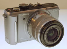 Panasonic Lumix GF 1 with lens G Lumix Vario 1:3.5-5.6 / 14-42 ASPH  H-FS1442A UV and original lens hood, battery, charger