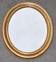 Large oval mirror in wood gilded with gold leaf, France, 19th century
