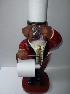 Large statue of a bulldog in nice costume as toilet roll holder