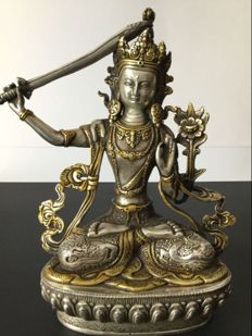 Depiction of the Manjushri Bodhisattva in a gold and silver-coloured patinated alloy - Nepal - late 20th century