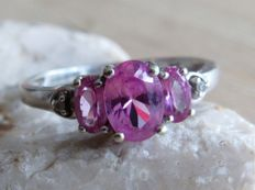 White Gold ring with three natural Pink Topazes and two Diamonds. No reserve price!