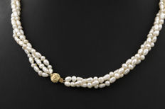 Three-strand pearl necklace with yellow gold tongue clasp