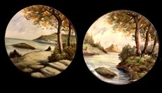 A pair of vintage spanish ceramic plates . hand painted & signed, with coastal and fluvial landscape
