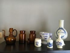 Nine old pharmacy containers