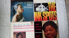 a great lot of Icons of the History of Music! Billy Holiday,Mahalia Jackson, Ella Fitzgerald, Shirley Bassey, Dionne Warwicke, the Platters, the Ink Spots and Roberta Flack and Peabo Bryson. a total of 11 albums including 4 doublealbums!