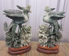 A couple of Phoenixes with nestlings on tree branch - China - 2nd half 20th century