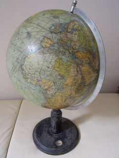 Old Columbus globe with economic and geographic entries