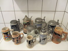 Collection of 10 old, high relief beer steins: