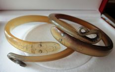 Set of two Victorian natural carved horn snake bangles.