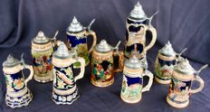 Lot of 9 beer steins, 3 of which are musical - porcelain and tin
