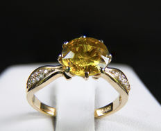 3.88 ct Russian sphene gold ring with diamonds.