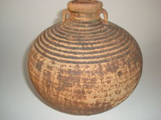 A large cambodian brown glazed wine jug with cycle of life design - 170 mm