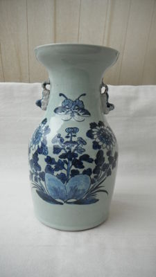 Baluster-shaped vase, celadon glaze with blue butterflies – China – Late 19th century