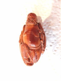 A beautiful carved wood netsuke of a Chinese sage - Japan - Early 20th century (Meiji Period)