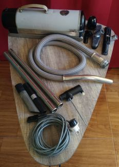 Vintage Electrolux vacuum cleaner with original accessories.