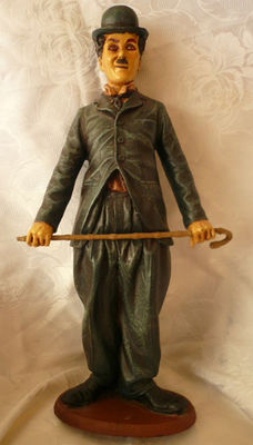 Vintage large figure of Charlie Chaplin with stick.