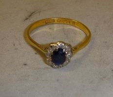 22ct gold Victorian ring with a sapphire set in a cluster of diamonds. 1863, hallmarked Birmingham