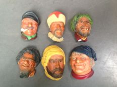 Six plaster heads - English-made - as wall hangers