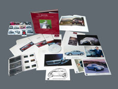 "Fine book: ""Rover the first ninety years 1904-1994"" - Rover 75 brochures, press-kit RoverTCV Geneva 2002 ,  lots of  press photos - Rover 200 and 400 brochures -  booklet ""Today's Cars""  (1991). Exiting press pictures of a 1997 Mini Spiritual Concept"