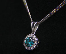 0.48ct blue diamond 14kt gold pendant with diamonds sides