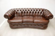 Brown leather, sprung Chesterfield couch, England, ca. 2000