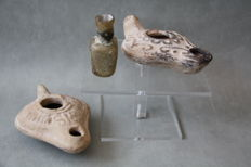 Early Islamic glass bottle, 2 x Holy Land terracotta oil lamps 400-600 AD. 91mm/86mm (3)