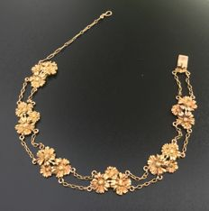 Vintage Art Nouveau bracelet with daisy decorations in 18 kt gold