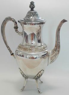 A large silver plated coffee pot.