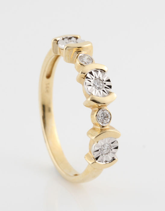 14 kt yellow and white gold diamond ring, 0.13 ct in total / weight 2.60 g / ring size 54 / G - H VS1-SI1 /