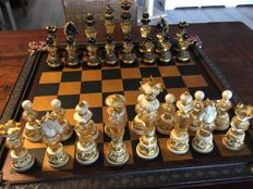 Chess set in chest with special amber-like chess pieces