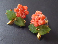 Yellow gold plated vintage ear studs with carved jade leaves and coral tulips.