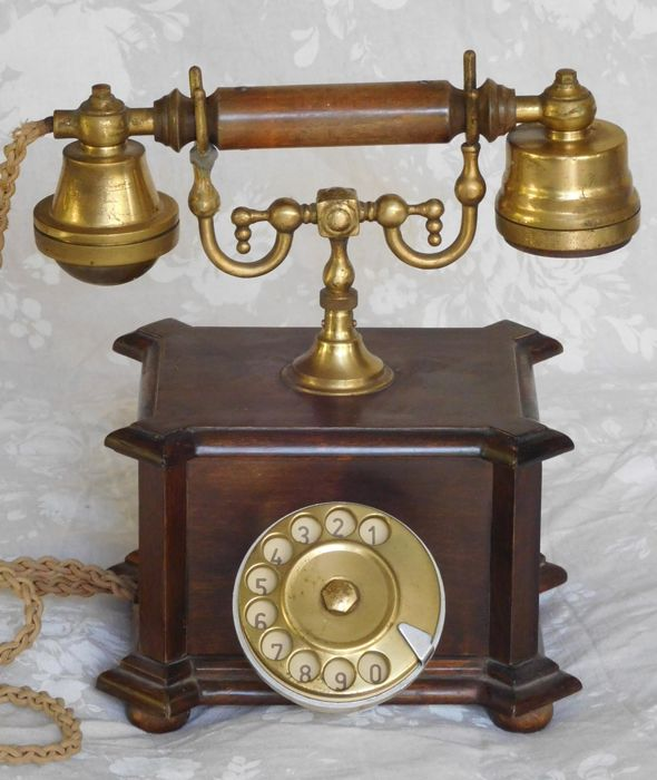 Old phone from wood and brass.